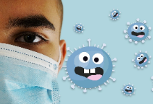 Student wearing mask with cartoon germs in background